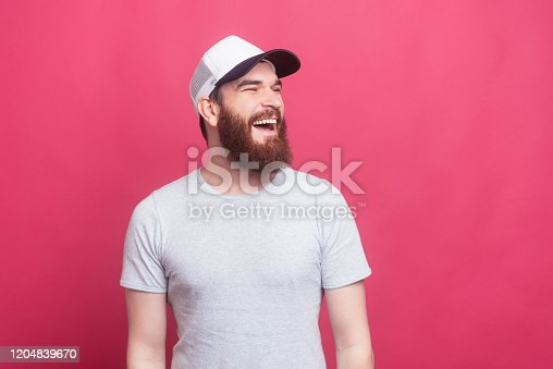 464621546 istock photo portrait of cheerful smiling trendy man looking aside 1204839670