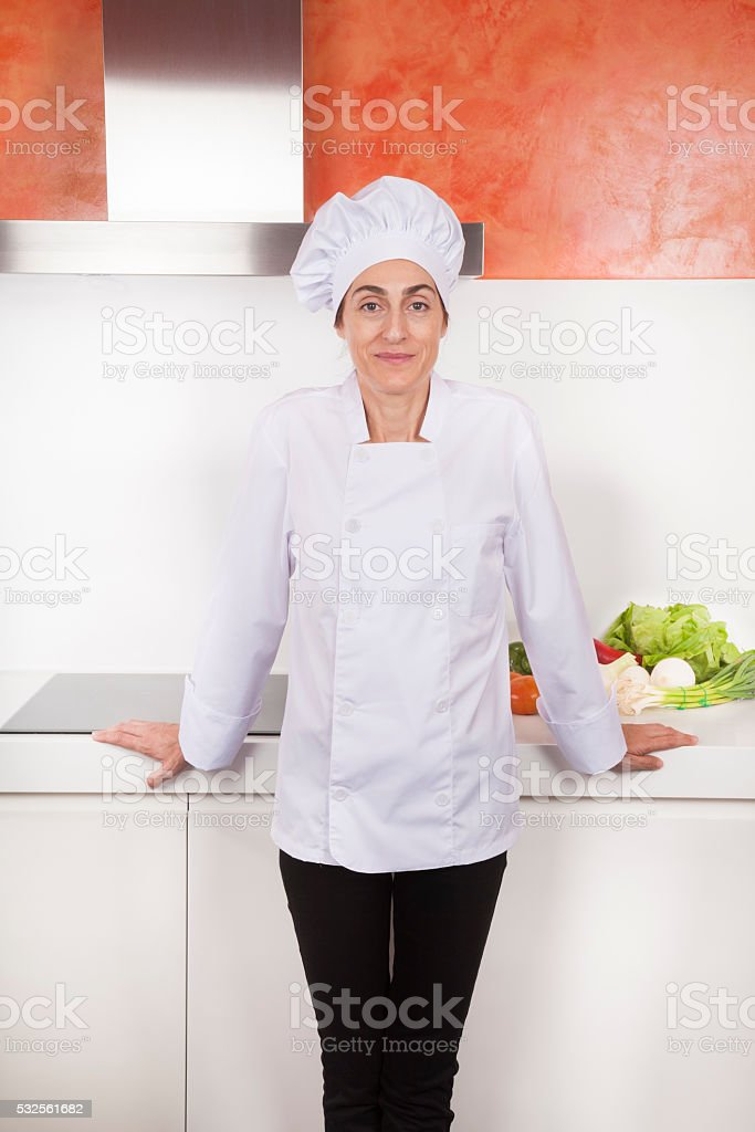 portrait of cheerful woman chef stock photo