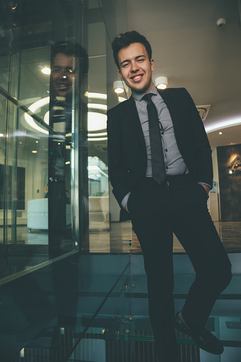825082848 istock photo Portrait of cheerful young businessman in office 1127816734