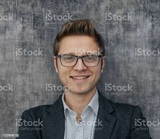 Portrait of cheerful young businessman picture id1127816715?b=1&k=6&m=1127816715&s=612x612&h=xpzthrthnjlltogdwkardivjmvzojtratw2p39zly0m=