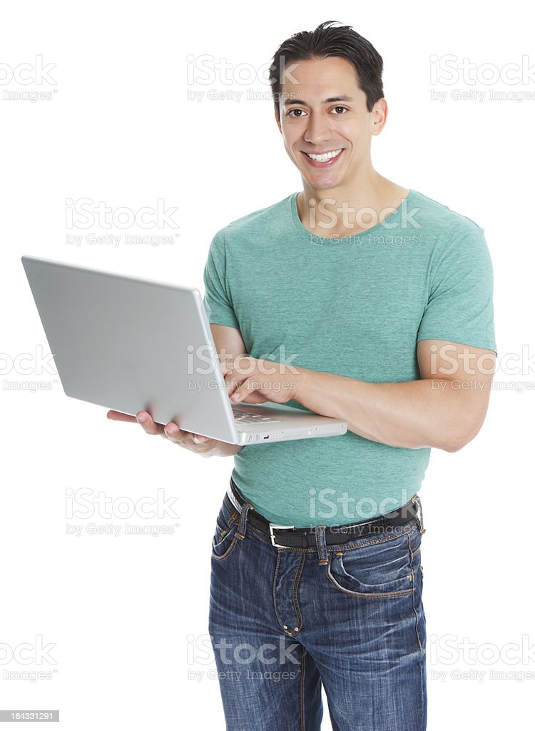 Portrait of cheerful young man using laptop royalty-free stock photo
