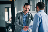 istock Portrait of cheerful young manager handshake with new employee. 1129342452