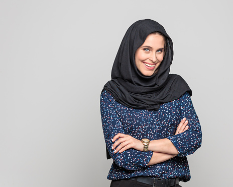 Portrait Of Cheerful Young Muslim Woman Stock Photo - Download Image Now