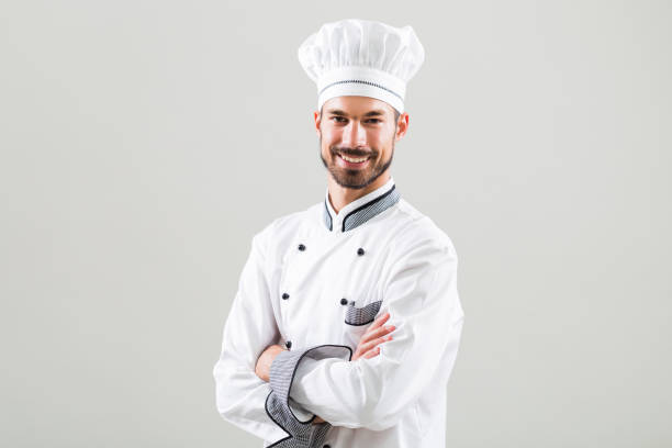 Portrait of chef Portrait of chef smiling on gray background. chef's whites stock pictures, royalty-free photos & images