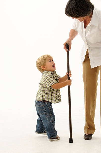 portrait of child and lady with cane stock photo