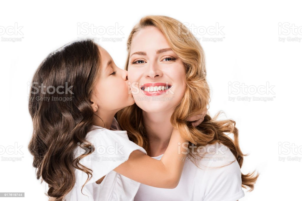 portrait of child kissing smiling mother isolated on white stock photo