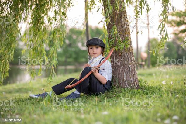 Portrait of child playing with bow and arrows archery shoots a bow at picture id1152848968?b=1&k=6&m=1152848968&s=612x612&h=sr9vyeqqqpoo7k1dikuhdnbv9ectpnujhpstncrjybw=
