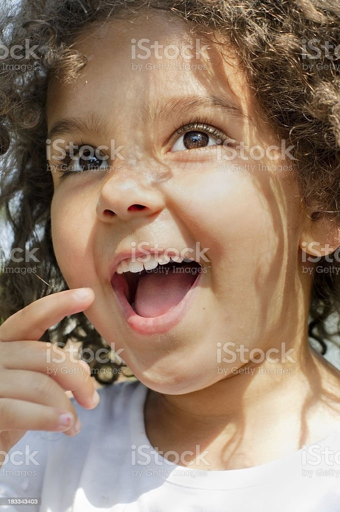 Portrait of Child (4-5) Smiling  with Wide Brown Eyes stock photo
