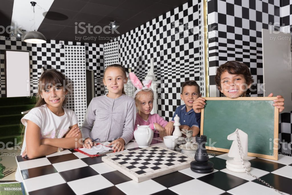 Portrait of children playing in the chess quest room stock photo