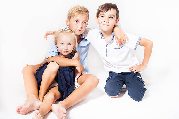Portrait of children, two boys and one girl stock photo
