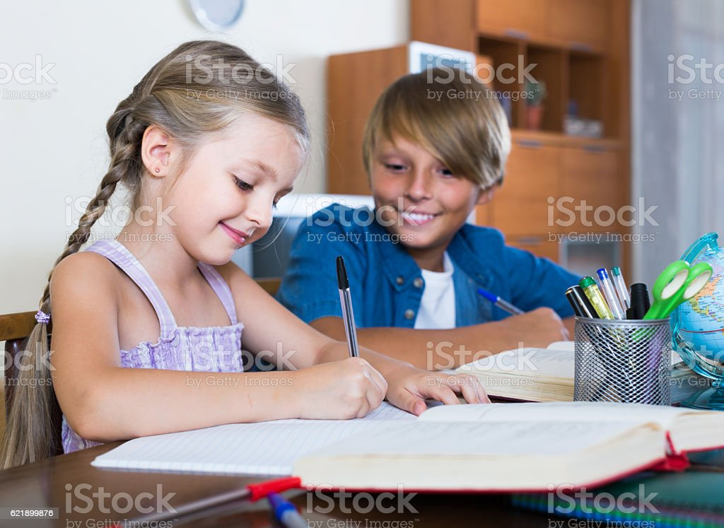 Portrait of children with textbooks and notes stock photo