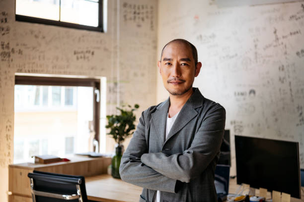 Portrait of Chinese businessman in creative office stock photo