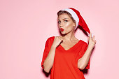 istock Portrait of christmas girl blowing kiss. 1165893599
