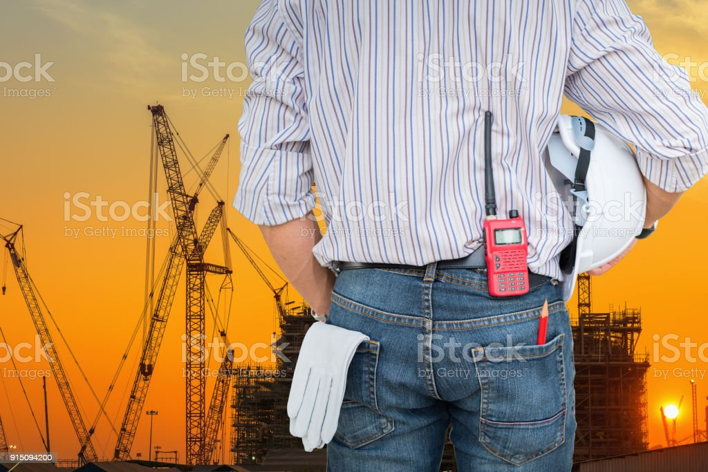 Portrait of civil engineer and Silhouette of construction activities stock photo