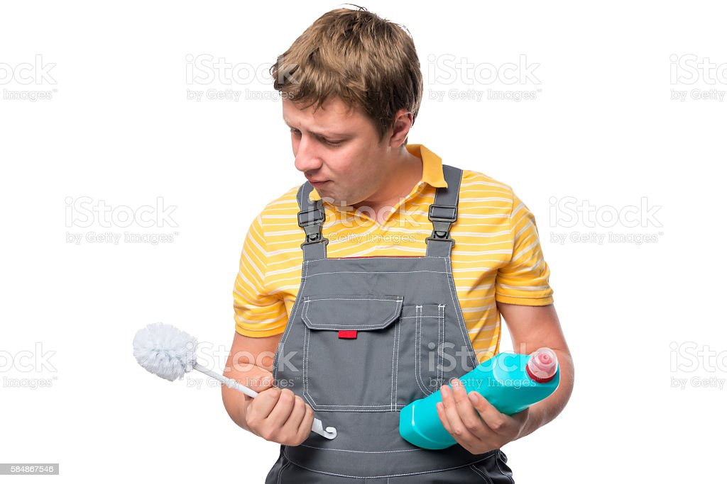 Portrait of cleaner with brush to clean the toilet stock photo