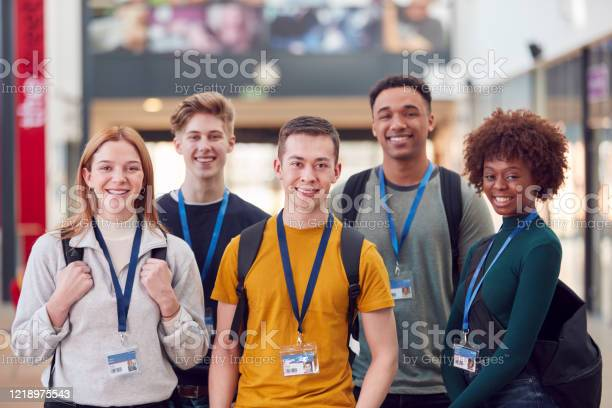 Portrait of college student friends meeting in busy communal campus picture id1218975543?b=1&k=6&m=1218975543&s=612x612&h=hvr71jq bp90tvu5n1ykos0lg1cqe49h7iyzxezayr4=