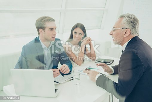 istock Portrait of concentrated business people discussing paperwork in office 947206104