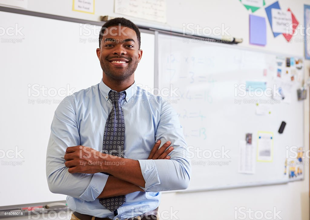 Portrait of confident African American male teacher in class stock photo