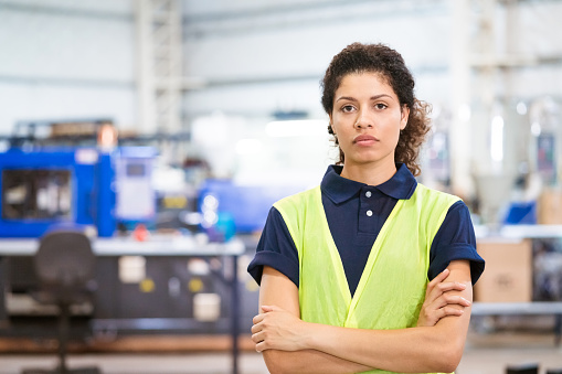 Portrait Of Confident Apprentice With Arms Crossed Stock Photo - Download Image Now
