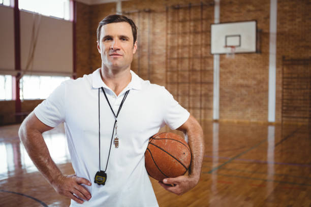 portrait of confident basketball coach - coach stock photos and pictures