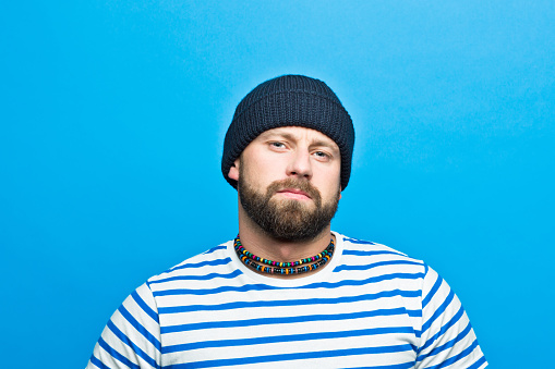 Portrait Of Confident Bearded Sailor Against Ble Background Stock Photo - Download Image Now