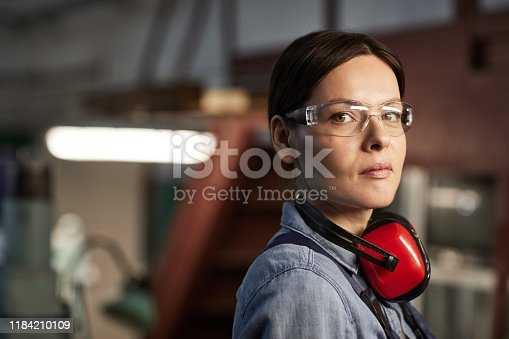 Beautiful lady working at industrial factory