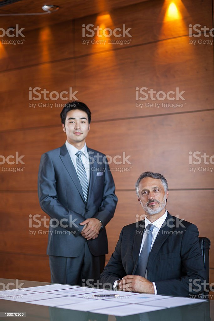 Portrait of confident business people in conference room stock photo