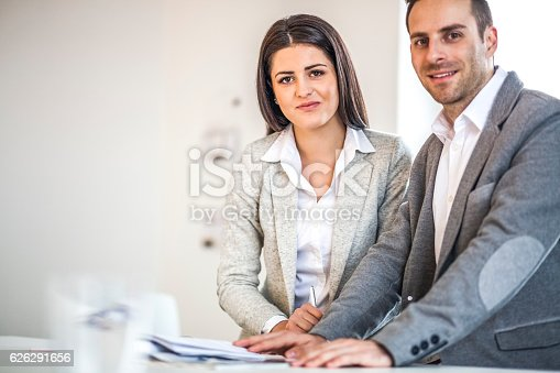 496441730 istock photo Portrait of confident business people working at desk in office 626291656