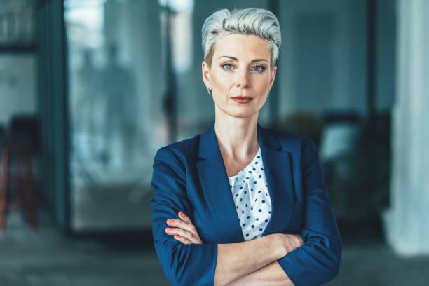 Portrait of confident business woman Portrait of confident, successful business woman at office ceo stock pictures, royalty-free photos & images