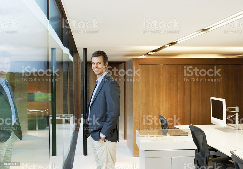 Portrait of confident businessman at office window royalty-free stock photo