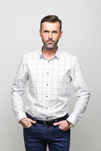 Portrait Of Confident Businessman Grey Background Stock Photo - Download Image Now