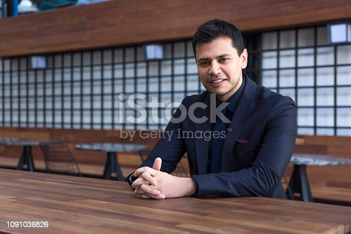 825082848istockphoto Portrait of confident businessman looking at camera 1091036826