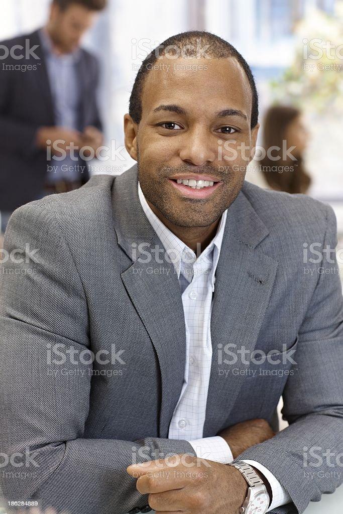 Portrait of confident businessman smiling royalty-free stock photo