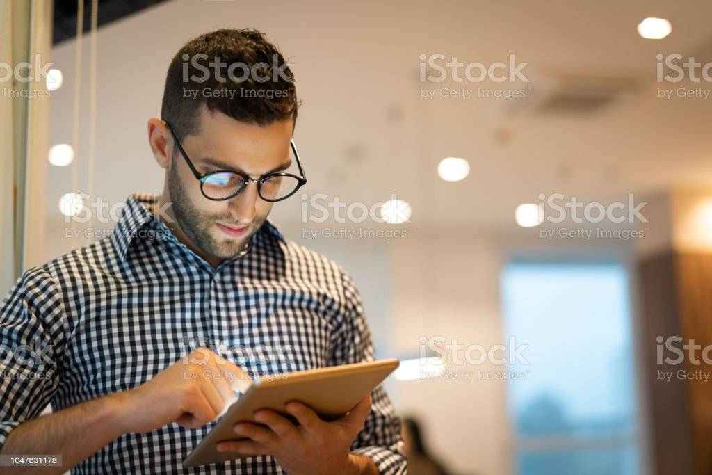 Portrait of Confident Businessman using tablet at office Real People 20-29 Years Stock Photo