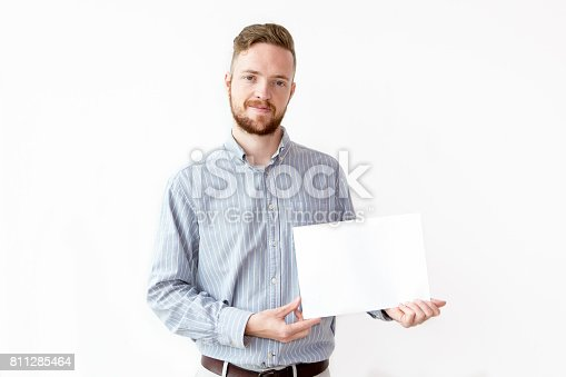 istock Portrait of confident businessman with blank paper 811285464