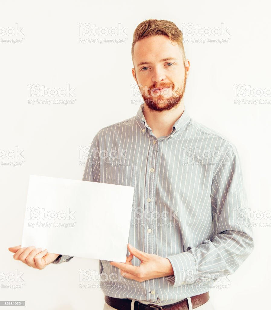 Portrait of confident businessman with blank paper stock photo