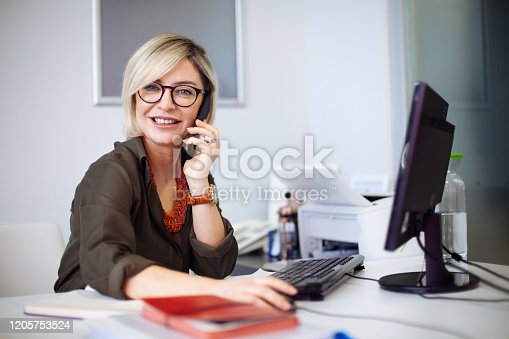 Portrait of confident businesswoman at workplace