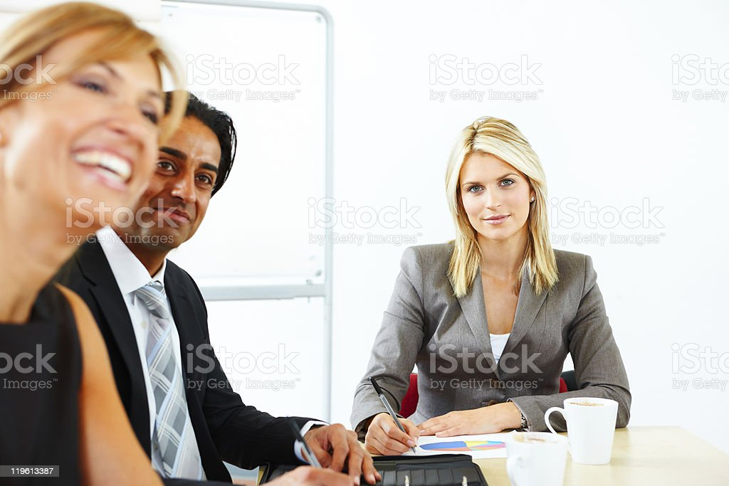 portrait of confident businesswoman in meeting with clients royalty-free stock photo