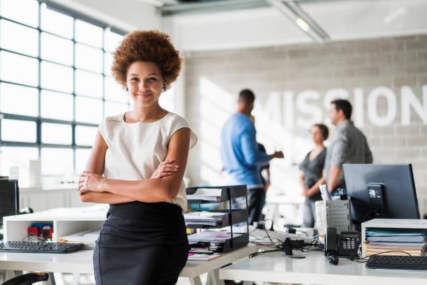 Portrait of confident businesswoman in office stock photo