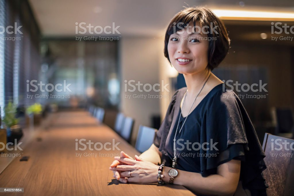 Portrait of confident businesswoman in office stock photo