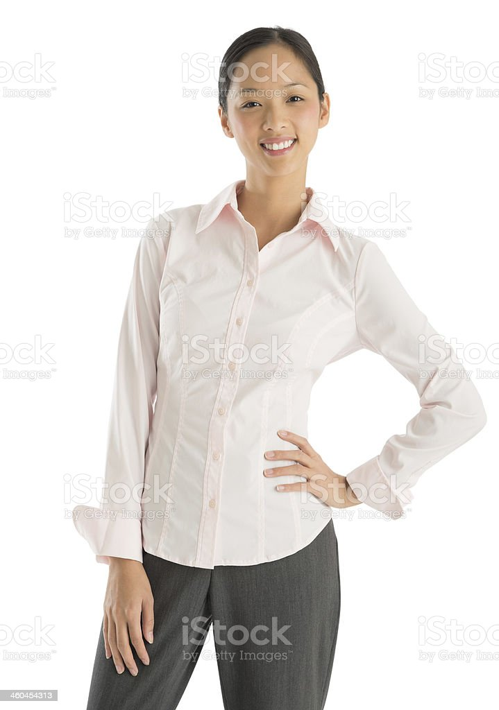 Portrait Of Confident Businesswoman Standing With Hand On Hip royalty-free stock photo