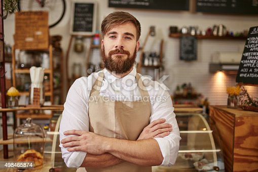 istock Portrait of confident cafe owner 498465874
