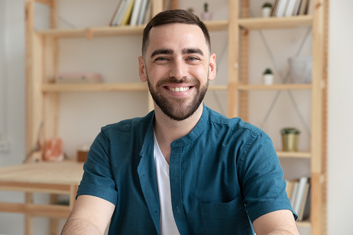 825082848 istock photo Portrait of confident Caucasian male employee in office 1227091094