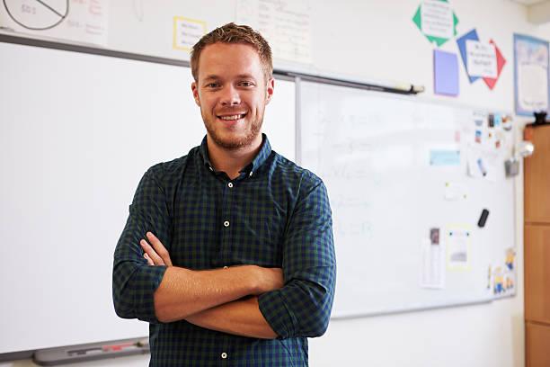 自信に満ちた白人男性のポートレート、教師のスクール形式 ストックフォト
