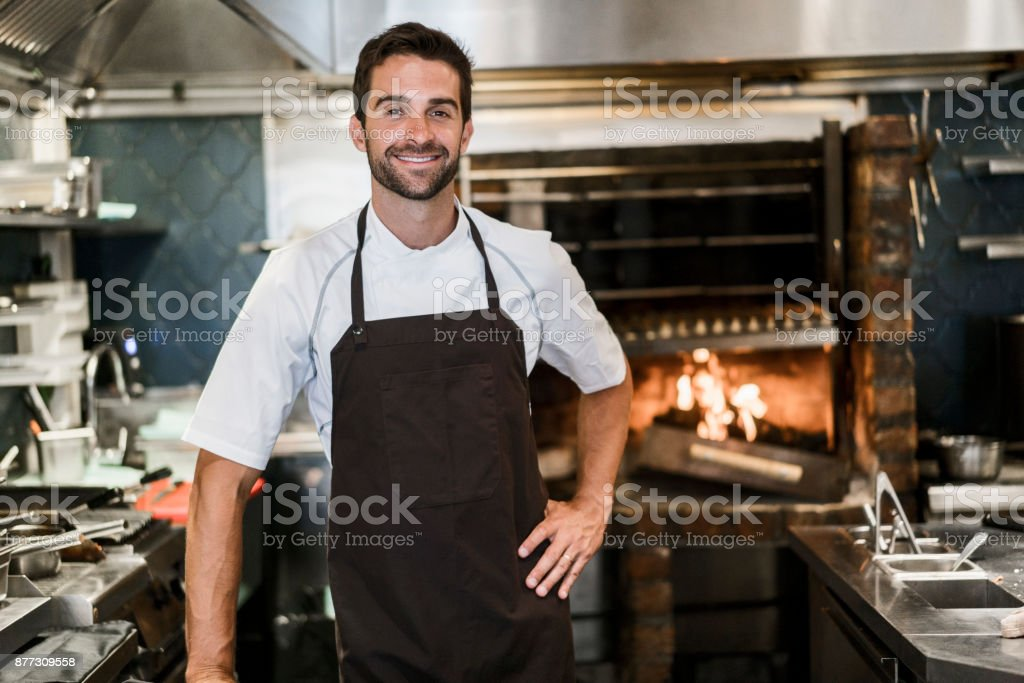 Portrait of confident chef in commercial kitchen stock photo