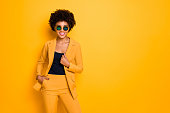 Portrait of confident cool sweet pretty dark skin girl dream feel content, expressions wear stylish outfit isolated over yellow color background