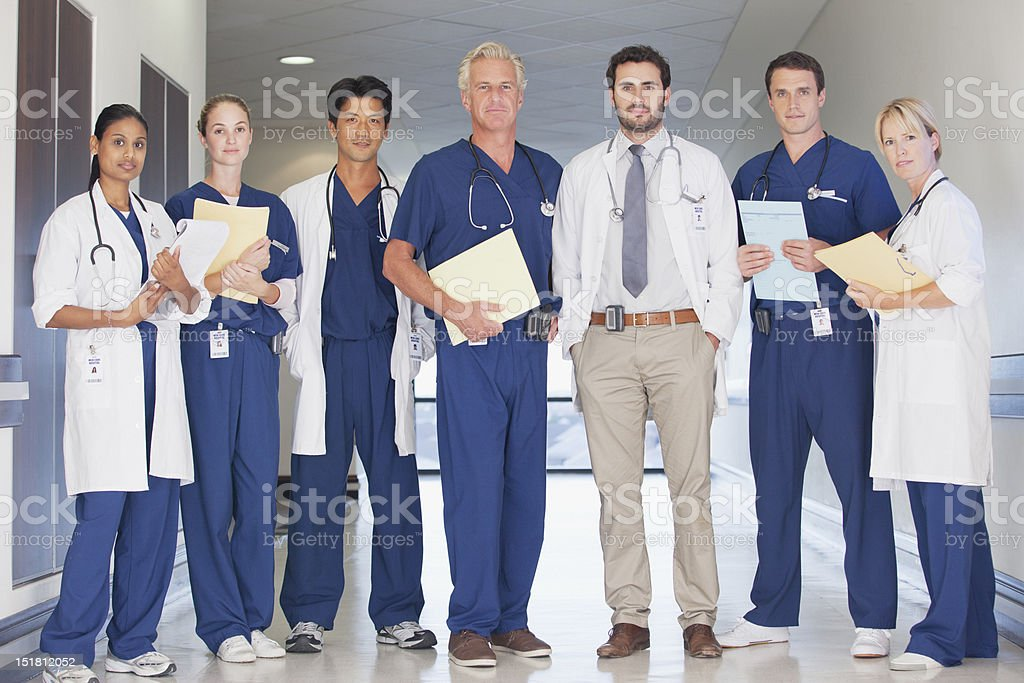 Portrait of confident doctors and nurses in hospital corridor stock photo