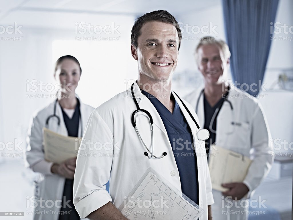 Portrait of confident doctors in hospital room royalty-free stock photo