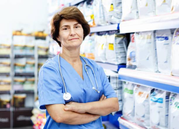 Portrait of confident elderly woman veterinarian standing near with picture id1084614878?b=1&k=6&m=1084614878&s=612x612&w=0&h=0szi7toizbi9a7fmaddyx16gmmhi2subrlcsg01kjpq=