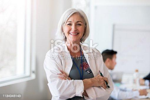 istock Portrait of confident female doctor 1134045143